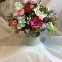 an ivory and pink flower arrangement