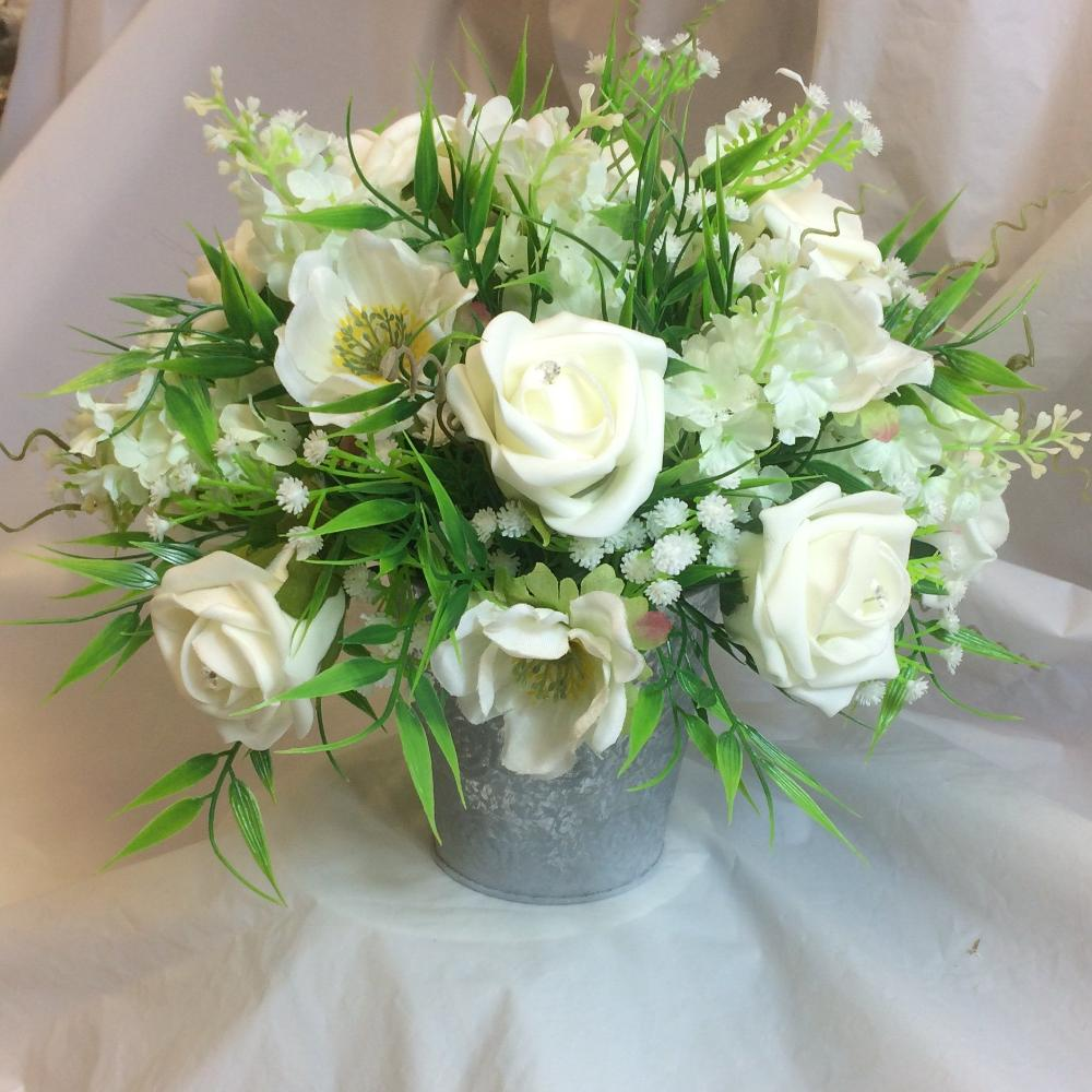 ivory artificial flower arrangement