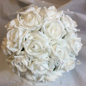 a wedding bouquet collection featuring ivory rose flowers with crystal strands