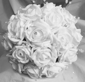 - A wedding bouquet collection of white foam roses and crystals