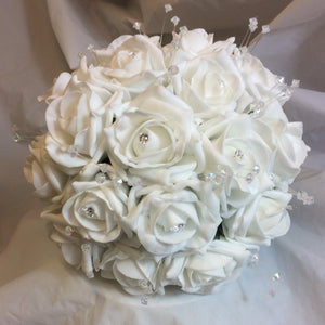 a wedding bouquet collection of white foam roses and crystals