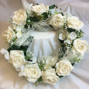 A bridesmaids flower hoop of ivory foam roses, ivy and lace