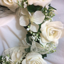 wired circlet of ivory foam roses, hydrangea and lace