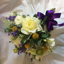 LAST ONE - A brides bouquet using white ivory and blue flowers