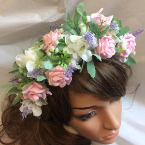 a flower crown of pink and lilac flowers