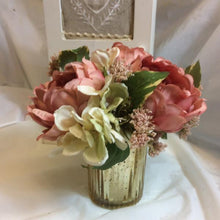 A flower arrangement of large peonies & hydrangea