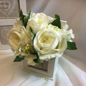 an ivory flower arrangement in cream shabby chic wooden box