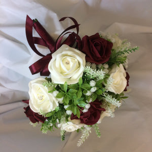 A wedding bouquet collection of burgundy & ivory foam roses