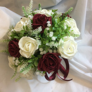 a burgundy and ivory wedding bouquet