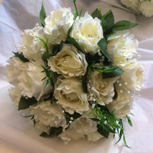 A wedding bouquet collection of silk ivory roses with diamante & pearls