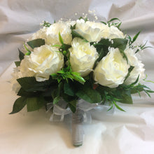 a wedding bouquet of ivory silk roses