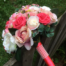 - A brides bouquet featuring apricot, coral and peach roses & hydrangea