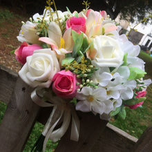 - a brides wedding bouquet of artificial pink & ivory hydrangea roses & lily