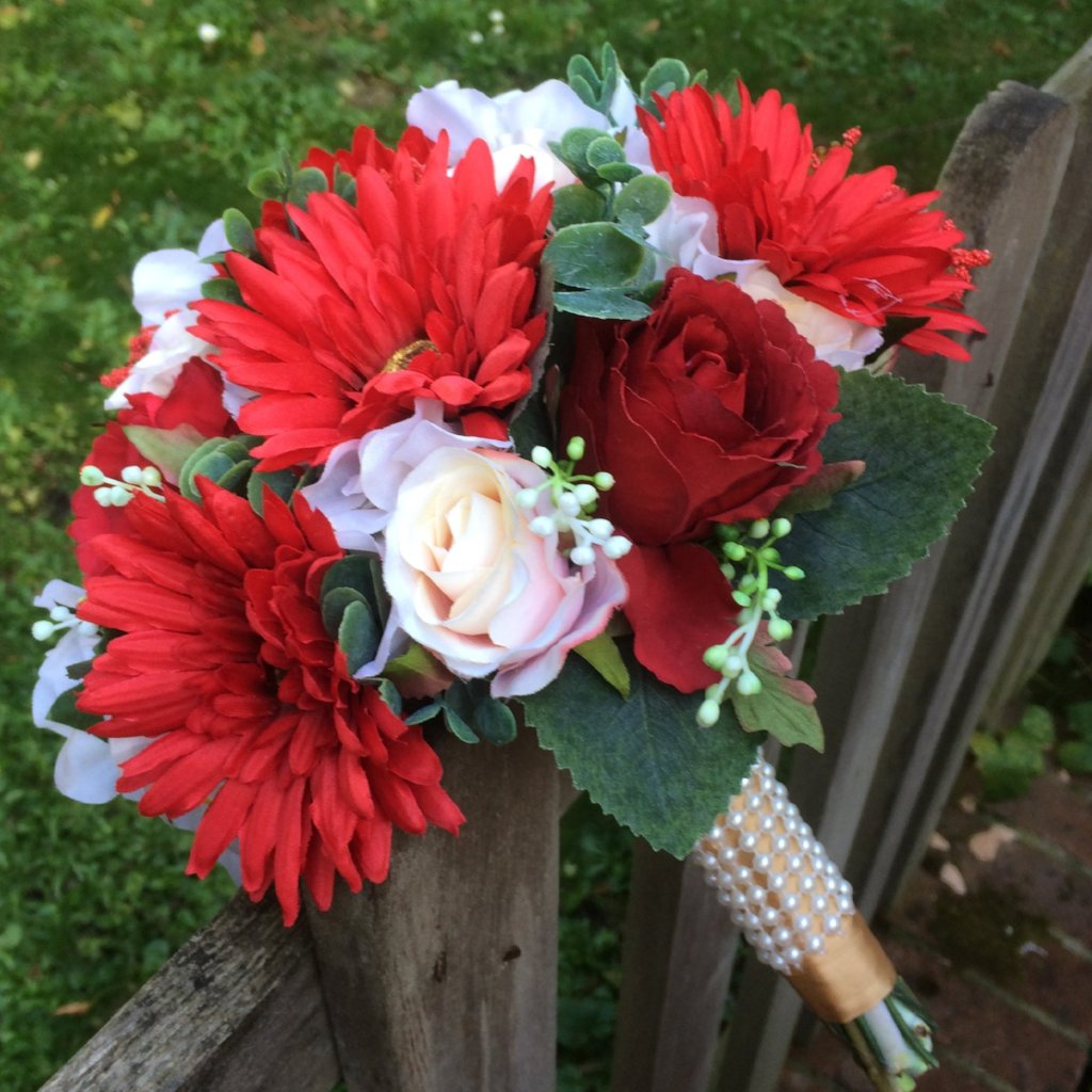 artificial silk wedding bouquet in shades of red, ivory and peach