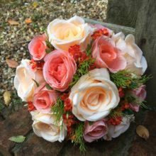 A wedding bouquet collection of artificial peach flowers