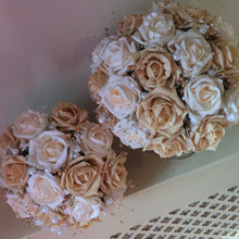 wedding bouquet of gold and cream foam roses and pearls