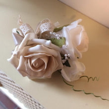 wedding corsage featuring foam roses in champagne, ivory and latte