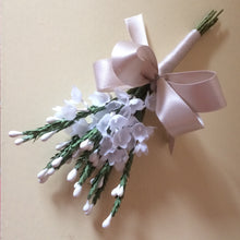 A buttonhole featuring artificial white heather