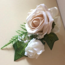 a corsage for the mothers of the bride