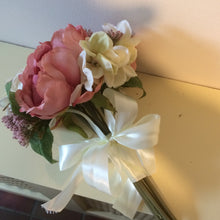 A bridesmaids wedding bouquet featuring ivory & dusky pink peonies