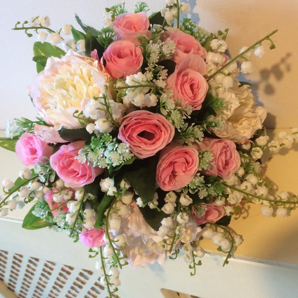 artificial wedding flower bouquet of pink roses, lily of the valley and peonies