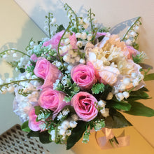 - An artificial wedding bouquet of artificial pink roses, peony & lily of the valley