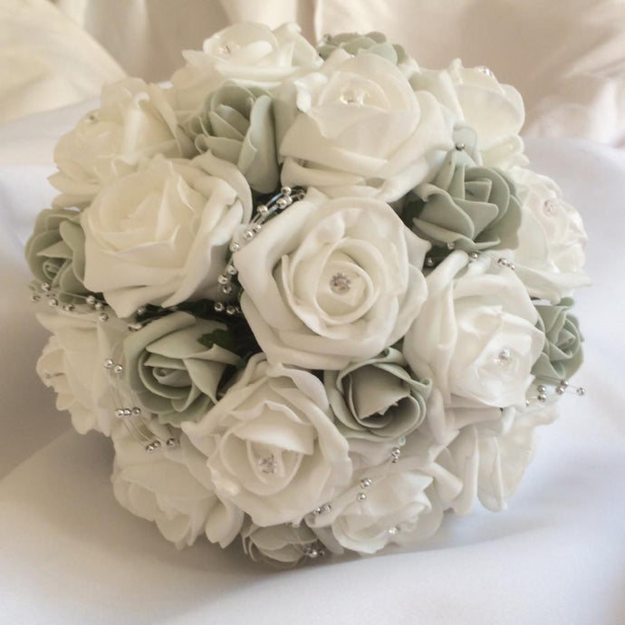 a wedding bouquet of foam roses in shades of silver grey and white