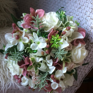 LAST ONE - A bridal bouquet featuring artificial flowers in shades of ivory and dusky pink