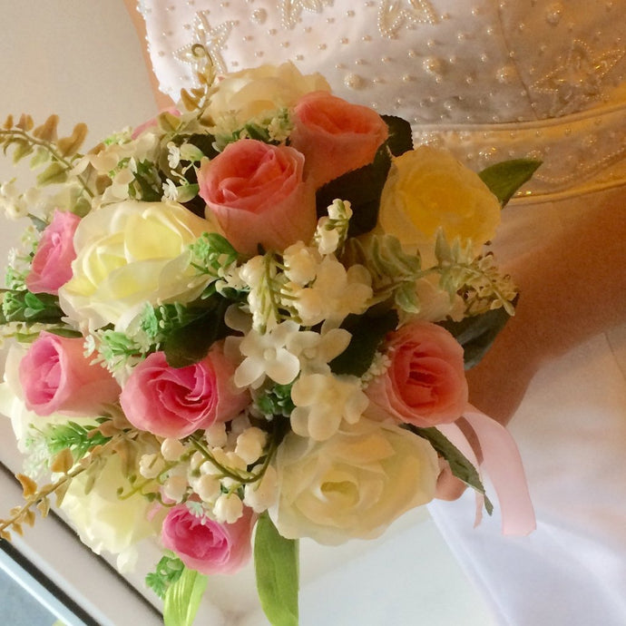 artificial wedding bouquet of pink and ivory flowers