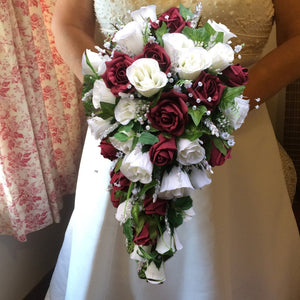 A teardrop bouquet of artificial foam and silk roses and crystals