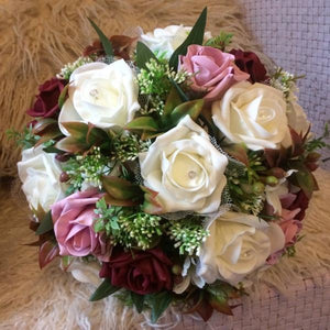 A wedding bouquet of artificial silk and foam rose flowers