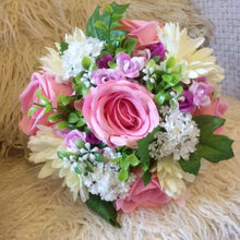 artificial wedding bouquet in shades of pink ivory and white