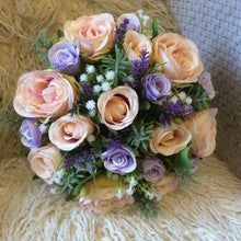 LAST ONE - A wedding bouquet featuring blush and lilac coloured artificial Flowers