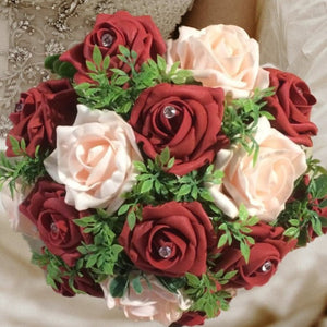 a wedding bouquet of artificial foam roses in shades of burgundy and baby pink