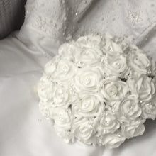a wedding bouquet of white foam roses with diamante centres and crystals