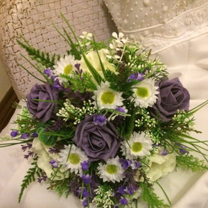 a wedding bouquet of daisies and roses