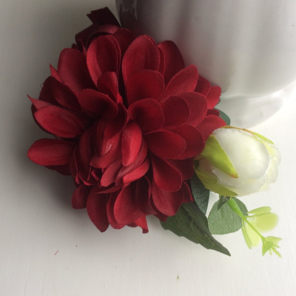 a wedding buttonhole of silk dahlia