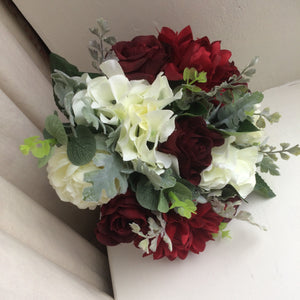 A wedding bouquet of artificial silk burgundy and ivory flowers