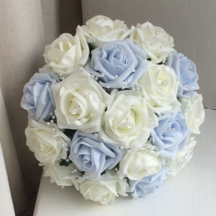 A bouquet collection of artificial baby blue & ivory foam roses with pearl centres