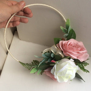 A bridesmaid flower hoop featuring artificial dusky pink silk roses