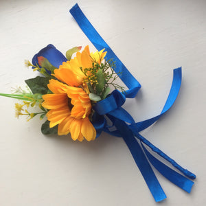 a bridesmaids flower wand of ivory lilac, sunflowers and royal blue rose
