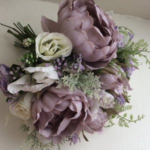 A Bride/adult Bridesmaids bouquet of roses, peonies tulips & lavender