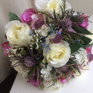 wedding bouquet of artificial roses and thistles