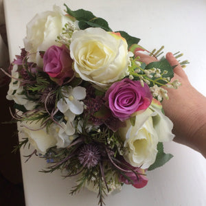 wedding bouquet of thistles and roses
