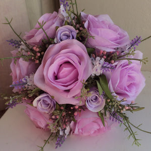 - A wedding bouquet of pink & lilac roses and lavender