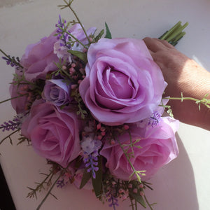 A wedding bouquet of pink & lilac roses and lavender