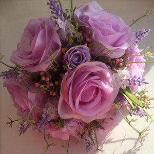 a wedding bouquet of lilac and lavender roses