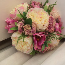 A bouquet for the bride of pink & cream peony and tulips