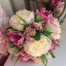 artificial wedding bouquet featuring peonies and tulips