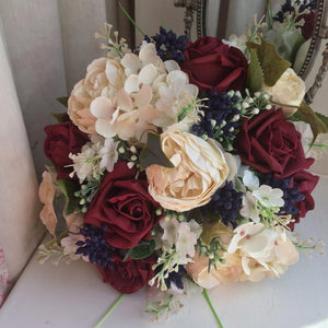 artificial wedding bouquet of burgundy and ivory flowers